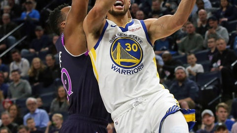 <p>               Golden State Warriors' Stephen Curry,right, lays up as Minnesota Timberwolves' Josh Okogie defends in the second half of an NBA basketball game Tuesday, March 19, 2019, in Minneapolis. The Warriors won 117-107. Curry led the Warriors with 36 points. (AP Photo/Jim Mone)             </p>