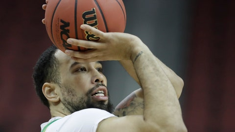 <p>               Oregon's Paul White shoots during practice for the NCAA men's college basketball tournament, Wednesday, March 27, 2019, in Louisville, Ky. (AP Photo/Darron Cummings)             </p>