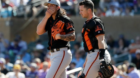 <p>               San Francisco Giants starting pitcher Dereck Rodriguez, left, talks with catcher Buster Posey, right, after loading the bases during the first inning of a spring baseball game against the Colorado Rockies in Scottsdale, Ariz., Sunday, March 3, 2019. (AP Photo/Chris Carlson)             </p>