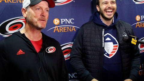 "<p>               FILE - In this Feb. 19, 2019, file photo, Tom Dundon, left, majority owner of the Carolina Hurricanes, and Charlie Ebersol, co-founder and CEO of the Alliance of American Football, talk to the media about Dundon's $250 million investment in the league, before an NHL hockey game between the New York Rangers and the Hurricanes in Raleigh, N.C. It's too early to tell what impact the Alliance of American Football will have on the sport itself. After all, this is its fourth weekend of games. Away from the field, with an infusion of backing from Dundon, the AAF is finding its footing. It's also finding what Ebersol calls ""substantial interest"" in the league in such areas as sponsorships and partnerships, with three new partners signing on since the season opener three weeks ago. (AP Photo/Chris Seward, File)             </p>"