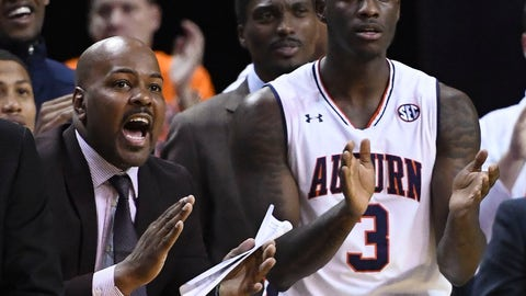 <p>               In this Jan. 19, 2019 photo, Auburn assistant coach Ira Bowman, left, cheers from the sidelines during the second half of an NCAA college basketball game against Kentucky in Auburn, Ala. Auburn has suspended Bowman indefinitely on Wednesday, March 3, 2019, amid allegations that he was involved in a bribery scheme during his time at the University of Pennsylvania. (AP Photo/Julie Bennett)             </p>