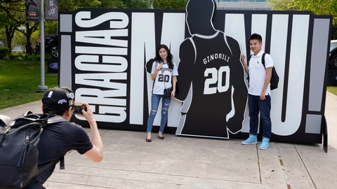 <p>               San Antonio Spurs fans pose for a photo in front of a sign thanking Spurs legend Manu Ginobili before an NBA basketball game against the Cleveland Cavaliers, Thursday, March 28, 2019, in San Antonio. Ginobili's jersey will be retired after the game. (AP Photo/Darren Abate)             </p>