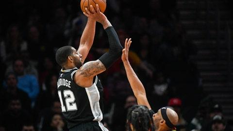 <p>               San Antonio Spurs center LaMarcus Aldridge (12) shoots as Atlanta Hawks forward Vince Carter defends during the second half of an NBA basketball game, Wednesday, March 6, 2019, in Atlanta. San Antonio won 111-104. (AP Photo/John Amis)             </p>