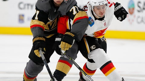 <p>               Vegas Golden Knights center William Karlsson (71) and Calgary Flames left wing Johnny Gaudreau (13) vie for the puck during the third period of an NHL hockey game Wednesday, March 6, 2019, in Las Vegas. (AP Photo/John Locher)             </p>