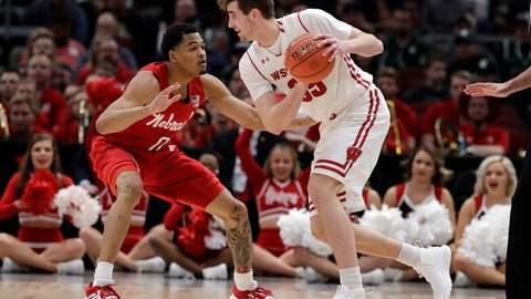 <p>               Wisconsin's Nate Reuvers (35) drives against Nebraska's James Palmer Jr. (0) during the first half of an NCAA college basketball game in the quarterfinals of the Big Ten Conference tournament, Friday, March 15, 2019, in Chicago. (AP Photo/Nam Y. Huh)             </p>