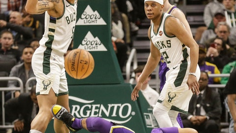 <p>               Los Angels Lakers' Josh Hart, bottom, looses the ball against the Milwaukee Bucks' D.J. Wilson, left, and Tim Frazier during the first half of an NBA basketball game Tuesday, March 19, 2019, in Milwaukee. (AP Photo/Jeffrey Phelps)             </p>