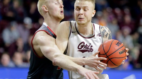<p>               Montana's Timmy Falls moves the ball around Eastern Washington's Ty Gibson during an NCAA college basketball game in the championship of the Big Sky Tournament in Boise, Idaho, Saturday, March 16, 2019. (AP Photo/Otto Kitsinger)             </p>