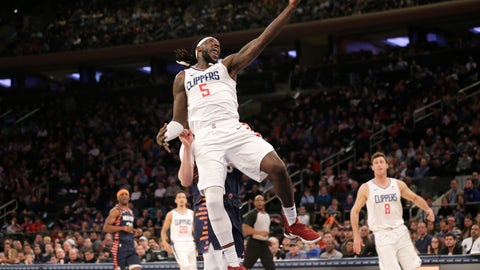 <p>               Los Angeles Clippers forward Montrezl Harrell (5) grabs a high pass during the first half of an NBA basketball game against the New York Knicks, Sunday, March 24, 2019, in New York. (AP Photo/Seth Wenig)             </p>