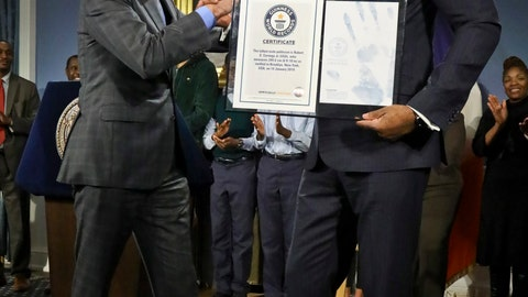 <p>               New York Mayor Bill de Blasio, left, awards N.Y. City Councilman Robert Cornegy, Jr. the Guinness World Record's tallest male politician, Wednesday March 27, 2019, at City Hall in New York. (AP Photo/Bebeto Matthews)             </p>