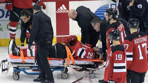 <p>               New Jersey Devils defenseman Mirco Mueller is wheeled off the ice on a stretcher after being injured during the third period of an NHL hockey game against the Calgary Flames Wednesday, Feb. 27, 2019, in Newark, N.J. The Flames defeated the Devils 2-1.(AP Photo/Bill Kostroun)             </p>