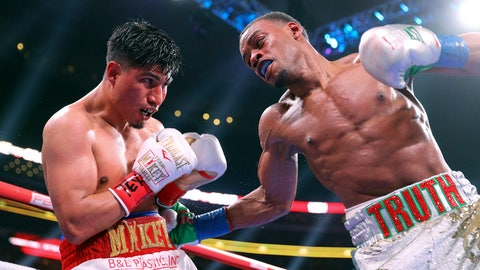<p>               Mikey Garcia, left, takes a blow to the body from Errol Spence Jr. during the ninth round of the IBF welterweight championship boxing bout Saturday, March 16, 2019, in Arlington, Texas. (AP Photo/Richard W. Rodriguez)             </p>