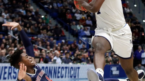<p>               Villanova's Eric Paschall, right, drives against St. Mary's Malik Fitts (24) during the second half of a first round men's college basketball game in the NCAA Tournament, Thursday, March 21, 2019, in Hartford, Conn. (AP Photo/Elise Amendola)             </p>