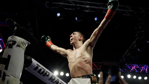 <p>               Ireland's Michael Conlan gestures to fans after a featherweight boxing match against Mexico's Ruben Garcia Hernandez on Sunday, March 17, 2019, in New York. Conlan won the fight. (AP Photo/Frank Franklin II)             </p>