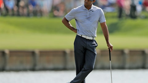 <p>               Tiger Woods reacts to hitting his drive into the water on the 17th hole during the second round of The Players Championship golf tournament Friday, March 15, 2019, in Ponte Vedra Beach, Fla. (AP Photo/Gerald Herbert)             </p>