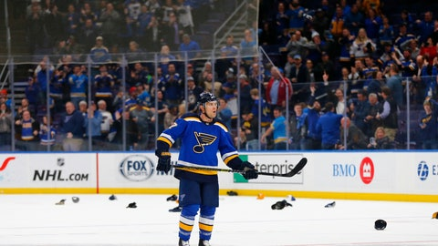 <p>               Fans throw their hats on the ice after St. Louis Blues' Jaden Schwartz (17) completed a hat trick against the Edmonton Oilers during the third period of an NHL hockey game Tuesday, March 19, 2019 in St. Louis. (AP Photo/Dilip Vishwanat)             </p>