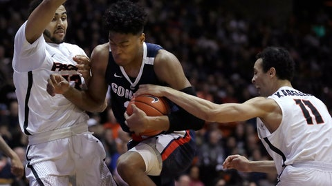 <p>               Gonzaga's Rui Hachimura, center, drives the ball between Pacific's Jeremiah Bailey, left, and Khy Kabellis during the first half of an NCAA college basketball game Thursday, Feb. 28, 2019, in Stockton, Calif. (AP Photo/Ben Margot)             </p>