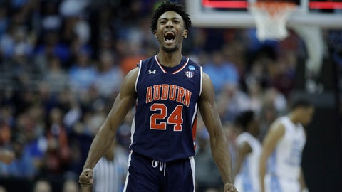 <p>               Auburn's Anfernee McLemore celebrates at the end of the first half of a men's NCAA tournament college basketball Midwest Regional semifinal game against North Carolina Friday, March 29, 2019, in Kansas City, Mo. (AP Photo/Charlie Riedel)             </p>