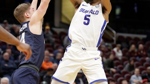 <p>               FILE - In this March 14, 2019, file photo, Buffalo's CJ Massinburg (5) shoots over Akron's Scott Walter (14) during the first half of an NCAA college basketball game of the Mid-American Conference tournament,  in Cleveland. Buffalo battles Arizona State in West Region action on Friday, March 22. (AP Photo/Tony Dejak, File)             </p>