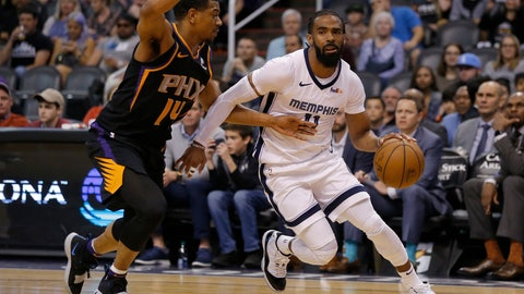 <p>               Memphis Grizzlies guard Mike Conley, right, drives past Phoenix Suns guard De'Anthony Melton, left, in the first half during an NBA basketball game, Saturday, March 30, 2019, in Phoenix. (AP Photo/Rick Scuteri)             </p>