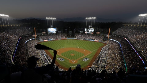 <p>               FILE - In this Oct. 27, 2018, file photo, fans cheer from the top of Dodger Stadium during Game 4 of the World Series baseball game between the Boston Red Sox and Los Angeles Dodgers in Los Angeles. Los Angeles police say a 47-year-old man was hospitalized after an argument turned violent outside Dodger Stadium. Police say the man was punched once by another man and fell to the ground in a parking lot following the six-hour game Friday night against the Arizona Diamondbacks. (AP Photo/Elise Amendola, File)             </p>