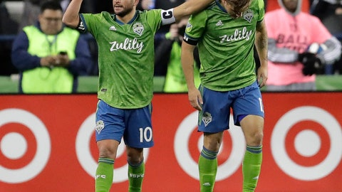 <p>               Seattle Sounders forward Jordan Morris, right, is greeted by midfielder Nicolas Lodeiro after Morris scored the first of his two first-half goals against FC Cincinnati during an MLS soccer match Saturday, March 2, 2019, in Seattle. Lodeiro assisted on the goal. (AP Photo/Ted S. Warren)             </p>
