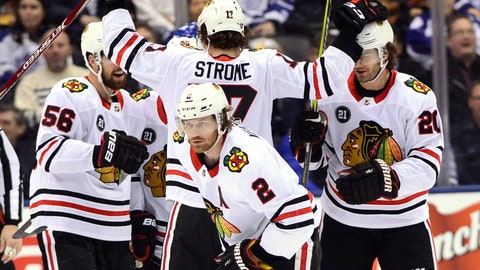 <p>               Chicago Blackhawks defenseman Duncan Keith (2) skates back to the bench after celebrating his goal against the Toronto Maple Leafs with teammates during the first period of an NHL hockey game Wednesday, March 13, 2019, in Toronto. (Frank Gunn/The Canadian Press via AP)             </p>