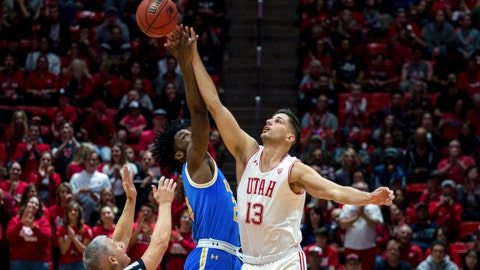 <p>               UCLA guard Jalen Hill, center, and Utah forward Novak Topalovic (13) jump for the ball in the first half of an NCAA college basketball game Saturday, March 9, 2019, in Salt Lake City. (AP Photo/Tyler Tate)             </p>