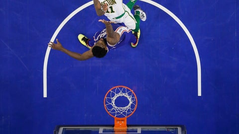 <p>               Boston Celtics' Kyrie Irving, top, tries to get a shot past Philadelphia 76ers' Joel Embiid during the first half of an NBA basketball game Wednesday, March 20, 2019, in Philadelphia. Philadelphia won 118-115. (AP Photo/Matt Slocum)             </p>