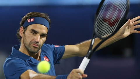 <p>               Roger Federer of Switzerland returns the ball to Marton Fucsovics of Hungry during their match at the Dubai Duty Free Tennis Championship, in Dubai, United Arab Emirates, Thursday, Feb. 28, 2019. (AP Photo/Kamran Jebreili)             </p>