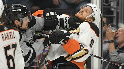 <p>               Los Angeles Kings center Adrian Kempe, left scuffles with Anaheim Ducks defenseman Korbinian Holzer during the second period of an NHL hockey game Saturday, March 23, 2019, in Los Angeles. (AP Photo/Mark J. Terrill)             </p>