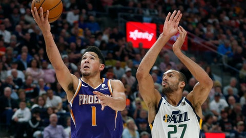 <p>               Phoenix Suns guard Devin Booker (1) lays up the ball as Utah Jazz center Rudy Gobert (27) defends during the first half of an NBA basketball game Monday, March 25, 2019, in Salt Lake City. (AP Photo/Rick Bowmer)             </p>