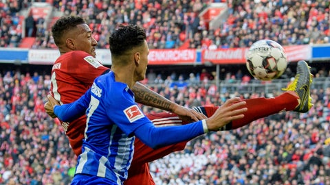 <p>               Munich's Jerome Boateng and Hertha's Davie Selke challenge for the ball during a German Bundesliga soccer match between Bayern Munich and Hertha BSC Berlin in Munich, Germany, Saturday, Feb.23,2019.  (Matthias Balk/dpa via AP)             </p>