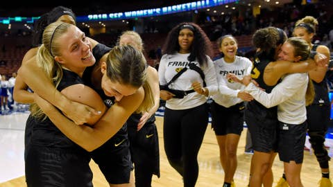 <p>               Missouri's Haley Troup, left, hugs Hannah Schuchts while teammates celebrate their overtime victory over Kentucky in a women's Southeastern Conference NCAA college basketball tournament game Friday, March 8, 2019, in Greenville, S.C. (AP Photo/Richard Shiro)             </p>