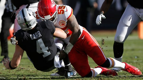 <p>               FILE - In this Dec. 2, 2018, file photo, Oakland Raiders quarterback Derek Carr (4) is tackled by Kansas City Chiefs linebacker Dee Ford (55) during the first half of an NFL football game in Oakland, Calif. The San Francisco 49ers opened the new league year Wednesday, March 13, by acquiring the defensive playmaker the team was sorely lacking in edge rusher Ford, as well as running back Tevin Coleman. The 49ers are sending a 2020 second-round pick to Kansas City for Ford and are giving him a new five-year contract, according to a person familiar with the deal who spoke on condition of anonymity because the trade hadn't been announced. (AP Photo/D. Ross Cameron, File)             </p>