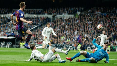 <p>               Barcelona midfielder Ivan Rakitic, left, scores the opening goal during the Spanish La Liga soccer match between Real Madrid and FC Barcelona at the Bernabeu stadium in Madrid, Saturday, March 2, 2019. (AP Photo/Manu Fernandez)             </p>