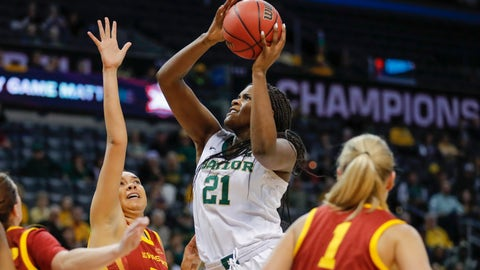 <p>               Baylor center Kalani Brown (21) goes to the basket as Iowa State forward Meredith Burkhall (32) defends during the first half of an NCAA college basketball game in the Big 12 women's conference tournament championship in Oklahoma City, Monday, March 11, 2019. (AP Photo/Alonzo Adams)             </p>