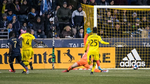 <p>               Philadelphia Union's David Accam, left, scores a goal against Columbus Crew's Joseph Bendik, back right, during the first half of an MLS soccer match, Saturday, March 23, 2019, in Chester, Pa. (AP Photo/Chris Szagola)             </p>