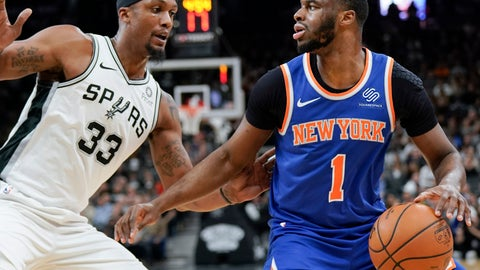 <p>               New York Knicks' Emmanuel Mudiay (1) looks to pass as he is defended by San Antonio Spurs' Dante Cunningham during the first half of an NBA basketball game Friday, March 15, 2019, in San Antonio. (AP Photo/Darren Abate)             </p>