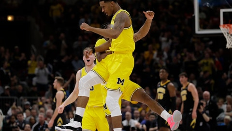 <p>               Michigan's Charles Matthews, front, celebrates with Zavier Simpson after scoring a 3-point basket during the first half of an NCAA college basketball game against the Iowa in the quarterfinals of the Big Ten Conference tournament, Friday, March 15, 2019, in Chicago. (AP Photo/Nam Y. Huh)             </p>