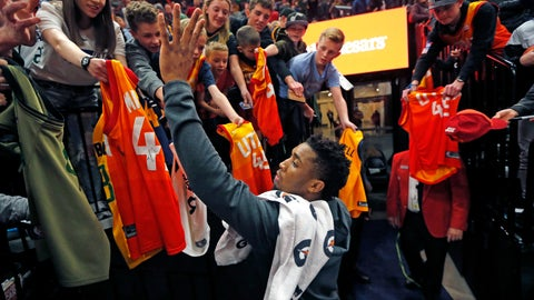 <p>               Utah Jazz guard Donovan Mitchell, center, gives autographs following an NBA basketball game against the Minnesota Timberwolves, Thursday, March 14, 2019, in Salt Lake City. (AP Photo/Rick Bowmer)             </p>