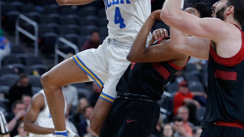 <p>               UCLA's Jaylen Hands shoots around Stanford's Marcus Sheffield, center, and Josh Sharma during the first half of an NCAA college basketball game in the first round of the Pac-12 men's tournament, Wednesday, March 13, 2019, in Las Vegas. (AP Photo/John Locher)             </p>