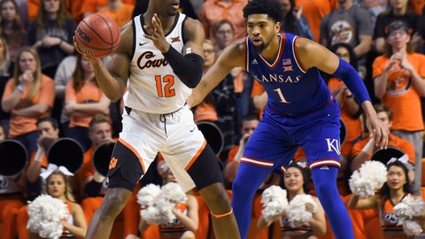 <p>               Oklahoma State forward Cameron McGriff (12) looks for an open teammate while under pressure from Kansas forward Dedric Lawson (1) during an NCAA college basketball game in Stillwater, Okla., Saturday, March 3, 2019. Lawson led Kansas scoring with 20 points in the 72-67 win over Oklahoma State. (AP Photo/Brody Schmidt)             </p>