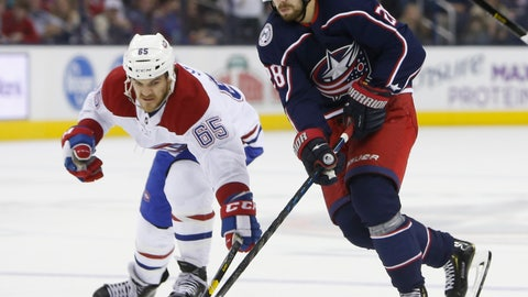 <p>               Montreal Canadiens' Andrew Shaw, left, and Columbus Blue Jackets' Oliver Bjorkstrand, of Denmark, chase a loose puck during the second period of an NHL hockey game Thursday, March 28, 2019, in Columbus, Ohio. (AP Photo/Jay LaPrete)             </p>