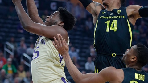 <p>               Washington's Noah Dickerson shoots around Oregon's Kenny Wooten (14) and Francis Okoro during the first half of an NCAA college basketball game in the final of the Pac-12 men's tournament Saturday, March 16, 2019, in Las Vegas. (AP Photo/John Locher)             </p>