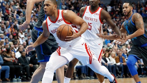<p>               Houston Rockets guard Eric Gordon (10) sprints to the basket past Dallas Mavericks forward Dirk Nowitzki, left rear, as Austin Rivers (25) and Devin Harris, right, watch in the first half of an NBA basketball game in Dallas, Sunday, March 10, 2019. (AP Photo/Tony Gutierrez)             </p>