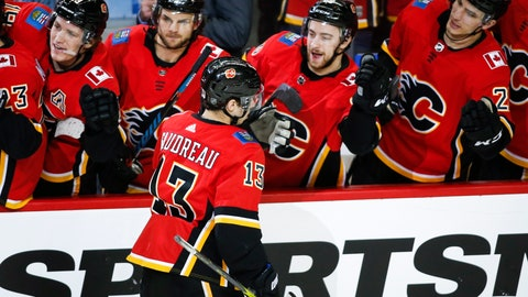 <p>               Calgary Flames' Johnny Gaudreau (13) celebrates his penalty-shot goal against the New Jersey Devils during the third period of an NHL hockey game Tuesday, March 12, 2019, in Calgary, Alberta. (Jeff McIntosh/The Canadian Press via AP)             </p>