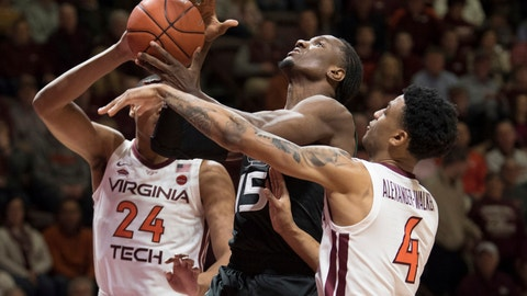 <p>               Miami center Ebuka Izundu (15) drives to basket against Virginia Tech defenders Nickel Alexander-Walker (4) and Kerry Blackshear Jr (24) during the first half of an NCAA college basketball game in Blacksburg, Va., Friday, March 8, 2019. (AP Photo/Lee Luther Jr.)             </p>