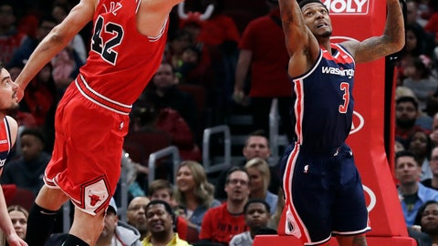 <p>               Washington Wizards guard Bradley Beal, right, and Chicago Bulls center Robin Lopez reach for a rebound during the first half of an NBA basketball game Wednesday, March 20, 2019, in Chicago. (AP Photo/Nam Y. Huh)             </p>