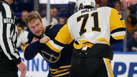 <p>               Buffalo Sabres forward John Larsson (22) and Pittsburgh Penguins forward Evgeni Malkin (81) fight during the third period of an NHL hockey game Thursday, March 14, 2019, in Buffalo, N.Y. (AP Photo/Jeffrey T. Barnes)             </p>