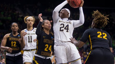 <p>               Notre Dame's Arike Ogunbowale (24) goes up for a shot between Bethune-Cookman's Angel Golden (24) and Tania White (22) during a first-round game in the NCAA women's college basketball tournament in South Bend, Ind., Saturday, March 23, 2019. (AP Photo/Robert Franklin)             </p>